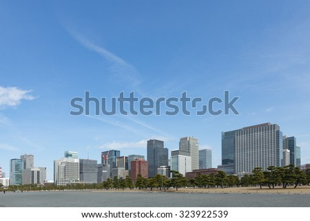 View of Tokyo's office district with skyscrapers from the imperial palace - stock photo