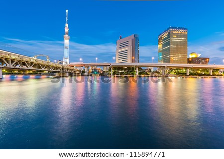View of Tokyo skyline from Sumida river - stock photo