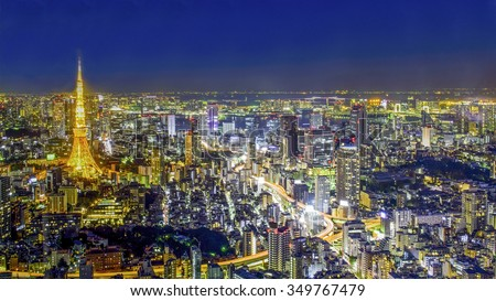 View of Tokyo Tower and surrounding buildings from Mori Tower, Roppongi, Tokyo. - stock photo