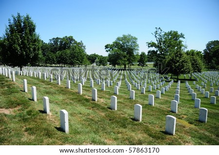 view of tombstone rows at Arlington National Cemetery - stock photo