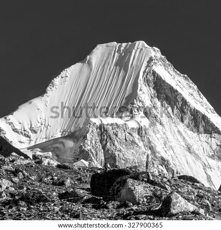 View of top of the peak Pumo Ri (7165 m) from Khumbu glacier - Nepal, Himalayas (black and white) - stock photo