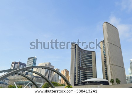 View of Toronto City Hall with blue sky as background