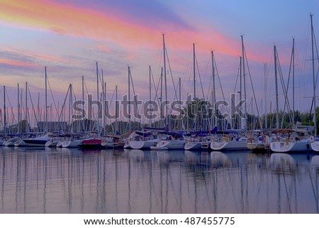 View of Toronto marina with many boats at sunset
