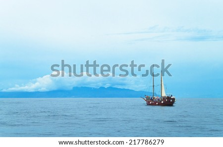 view of tourist pirate ship approaching las palmas, canary islands - stock photo