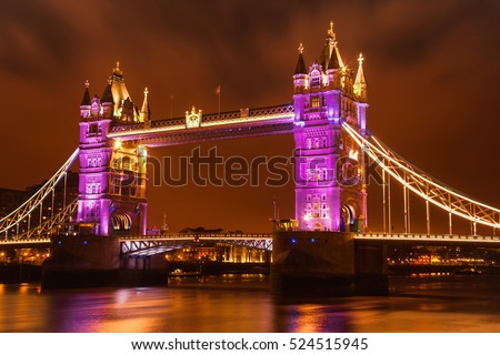 View of Tower Bridge festively illuminated.