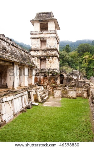 View of tower from inside 'The Palace' with steamy jungle in background at the ancient Mayan city of Palenque. Chiapas, Mexico.