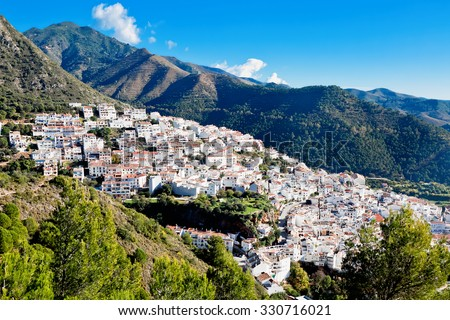 View of town and surrounding countryside, Ojen, Malaga Province, Andalusia, Spain - stock photo