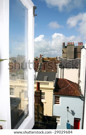view of town through open window. City of brighton in england