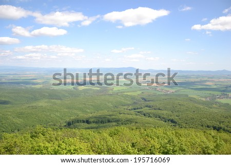 View of trees, mountains, hills, fields and villages from Marhat, Slovakia - stock photo