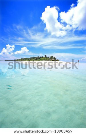 View of tropical island from the sea - stock photo