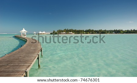 View of tropical paradise island and walkway - stock photo