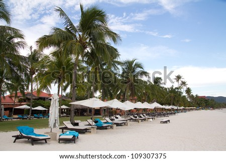 View of tropical resort on beach in the morning