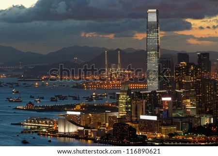 View of Tsim Sha Tsui in Hong Kong in a clear sunset evening. - stock photo