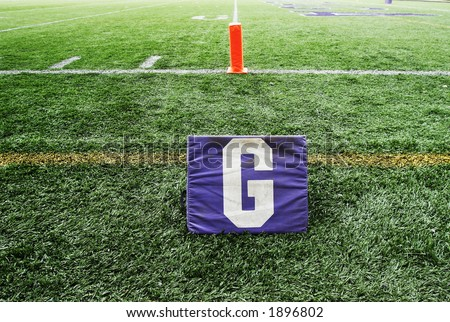 View of turf and American football field goal line. - stock photo