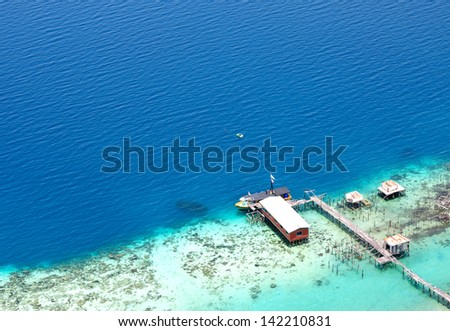 View of Turquoise Ocean and Jetty from the top of an island in borneo, Malaysia - stock photo