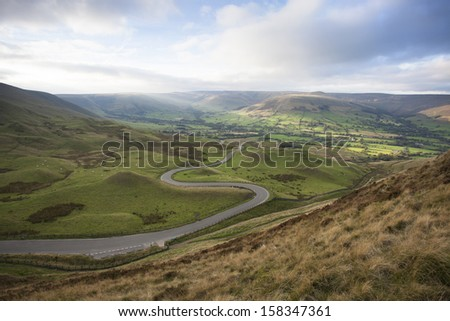 view of twisty road in mountains, peak district, derbyshire