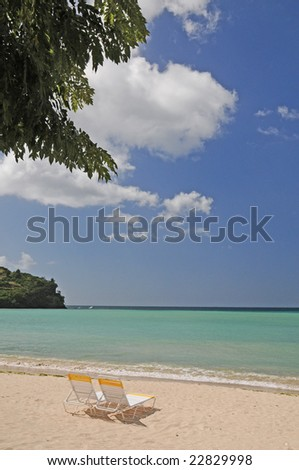 View of two chairs on a deserted beach - stock photo