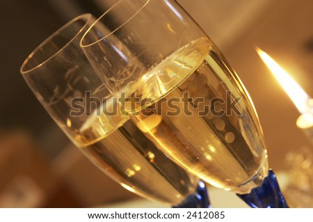 view of two flutes glass and a bottle of Champagne - stock photo