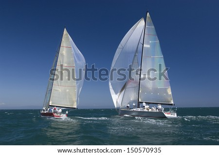View of two yachts competing in team sailing event