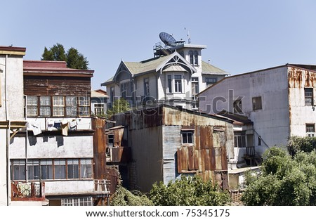 View of typical houses of the chilean city of Valparaiso on a hill - stock photo