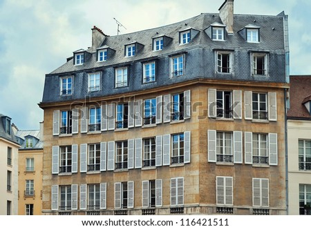 View of Unique traditional French windows and balconies. Paris, - stock photo
