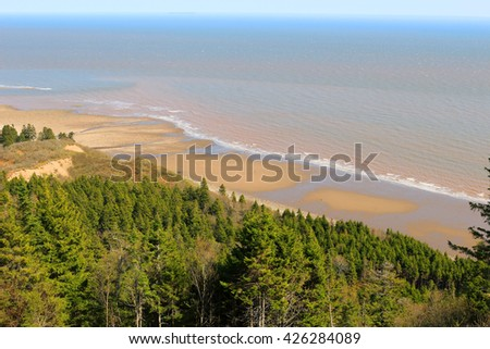 View of unspoilled wilderness with cliffs and Long Beach on the Fundy trail in New Brunswick, Canada - stock photo
