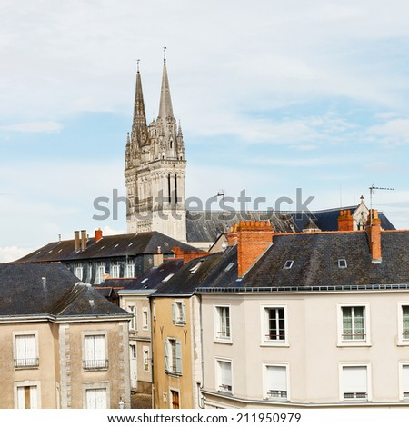 view of urban houses and Saint Maurice Cathedral in Angers, France - stock photo