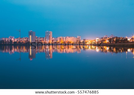 View Of Urban Residential Area Overlooks To City Lake Or River And Park In Evening Illumination, Reflecting In Water Surface. Spring In Gomel Belarus. City Residential Architecture