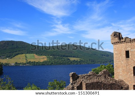 View of Urquhart Castle and Loch Ness in the Highlands of Scotland - stock photo
