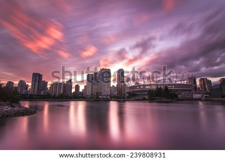 View of Vancouver downtown with BC Stadium from False Creek at sunset time - stock photo