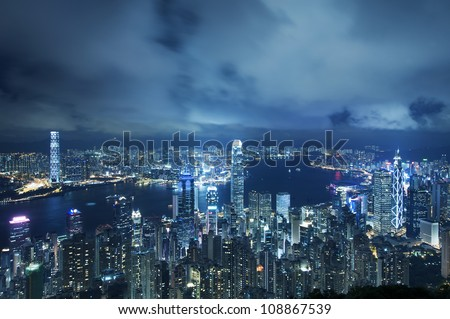 View of Victoria harbor from the peak at Hong Kong - stock photo