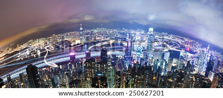 View of Victoria Harbour in Hong Kong from the Peak, long exposure with light trails of moving ships - stock photo