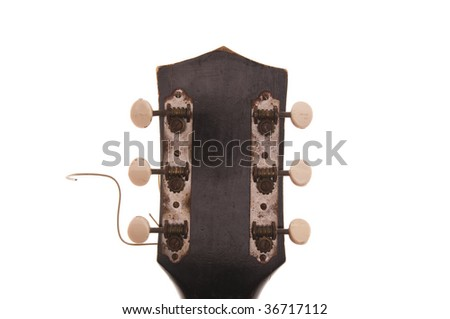 View of vintage, rusty, cracked, worn guitar headstock, white iso. - stock photo