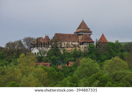 View of Viscri fortified church (castle), Transylvania, Romania,  UNESCO heritage site, german landmark in romanian country - stock photo