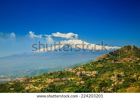 view of volcano Etna from the town Castelmola, Sicily, Italy - stock photo