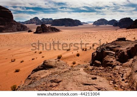 View of Wadi Rum desert, Jordan from a mountain. - stock photo