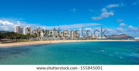 View of Waikiki and Diamond Head from Magic Island at Ala Moana Beach Park. - stock photo
