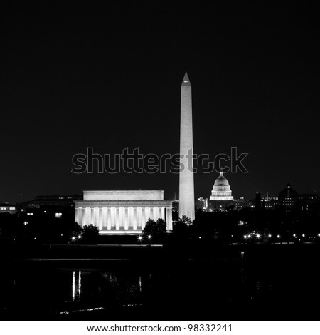 View of Washington DC skyline at night with lit up Lincoln Memorial, Washington Monument and the Capitol - stock photo