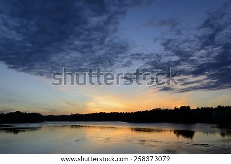 View of Water and Sky at Sunset - stock photo