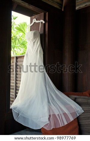 view of wedding dress is hanging awaiting  ceremony