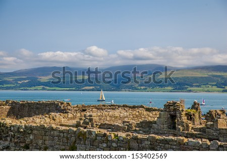 View of welsh countryside over castle wall - stock photo