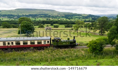 View of Wensleydale with steam train - stock photo