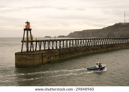 View of Whitby Harbour, overcast sky, With boat.