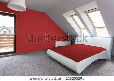View of white and red modern bedroom - stock photo