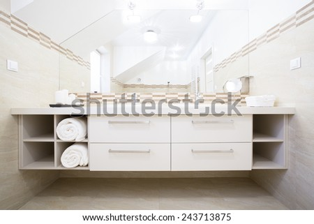 View of white furniture in bright bathroom - stock photo