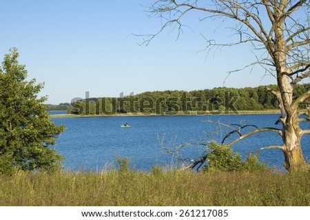 View of wild shore of the lake in Masuria district, Poland