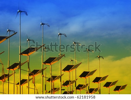 View of wind generators and solar panels - stock photo