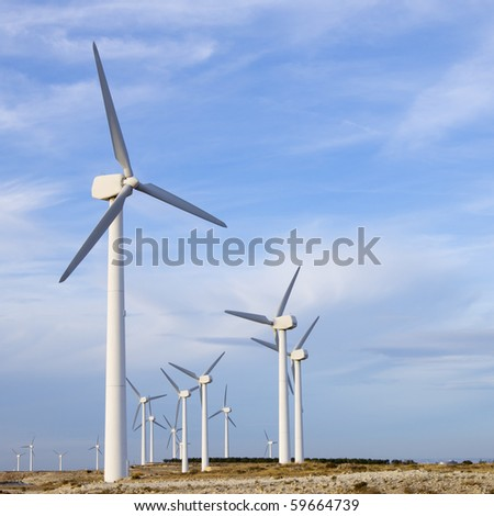 view of windmills group with cloudy sky - stock photo