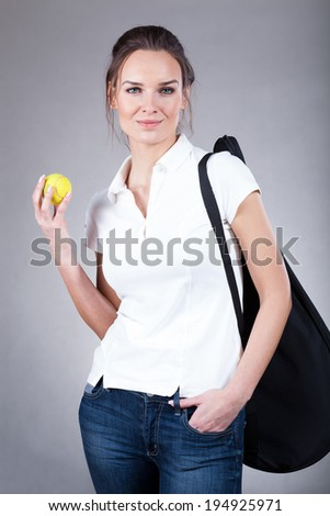 View of woman going to tennis training - stock photo