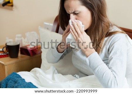 View of woman in bed feeling cold - stock photo